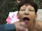 Brunette granny pleasing younger dong in woods