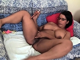 Ebony beauty Natalia Johnson rubs her big boobs and